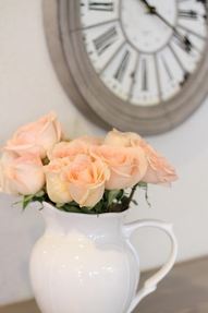 fresh peach rose floral in crisp white vase